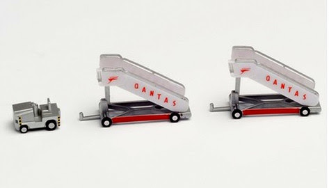 571005   Herpa Wings 1:200 1:200   Airport Accessories - Qantas historic passenger stairs and tow tractor   is due: September 2020