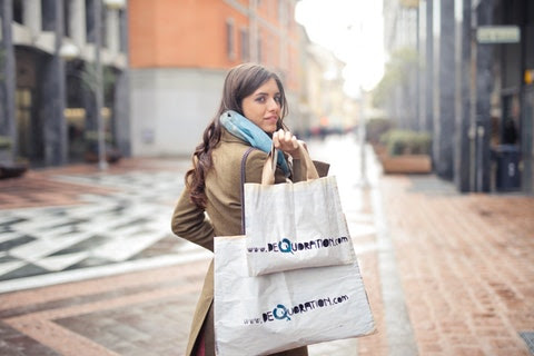 business tips and tricks - woman holding shopping bags