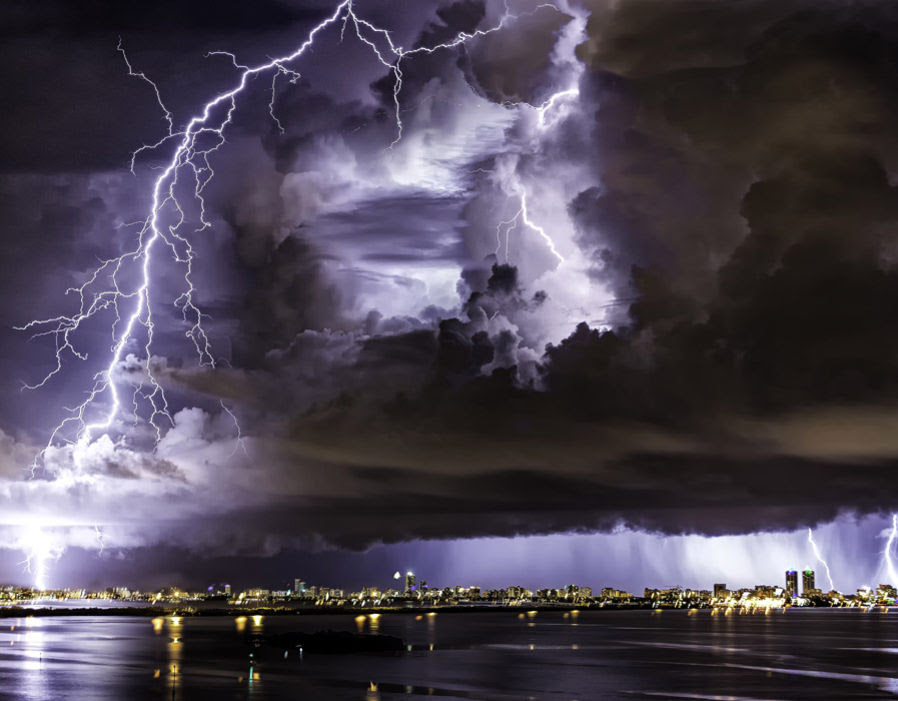 These frightening photos of lightning from a hurricane above Miami, Florida in the USA were taken after the storm left a trail of destruction in the Caribbean.