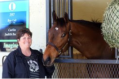 Marne Fauber of Imagine... with Hip 397, a Curlin colt, at the OBS March sale of 2-year-olds in training