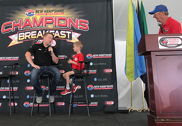 Tyler Reddick, Elliot Perry, Dick Berggren at Champions Breakfast 071919 620x430.jpg