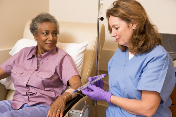 nurse giving patient an infusion