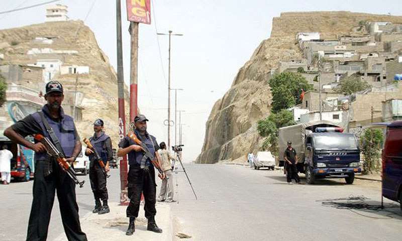 Police commandos petrol Karachis violent Kati Pahari (Split Mountain) area. One side of the hill is populated by Mohajirs and the other by Pakhtuns.