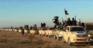 ISIS soldiers in convoy in confiscated trucks in Iraq. Photo: Twitter / nayelshafei.