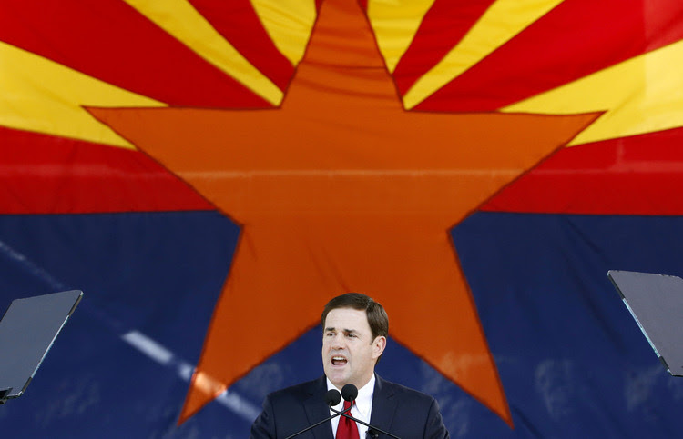 Gov. Doug Ducey&nbsp;(R-Ariz.) addresses the crowd after being inaugurated&nbsp;in Phoenix in 2015. (Ross D. Franklin/AP)</p>