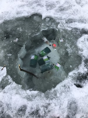 trash left behind on lake after ice fishing