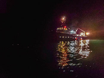 The Survey Vessel Steelhead shown on the water at night over the Good Harbor Reef in 2020.