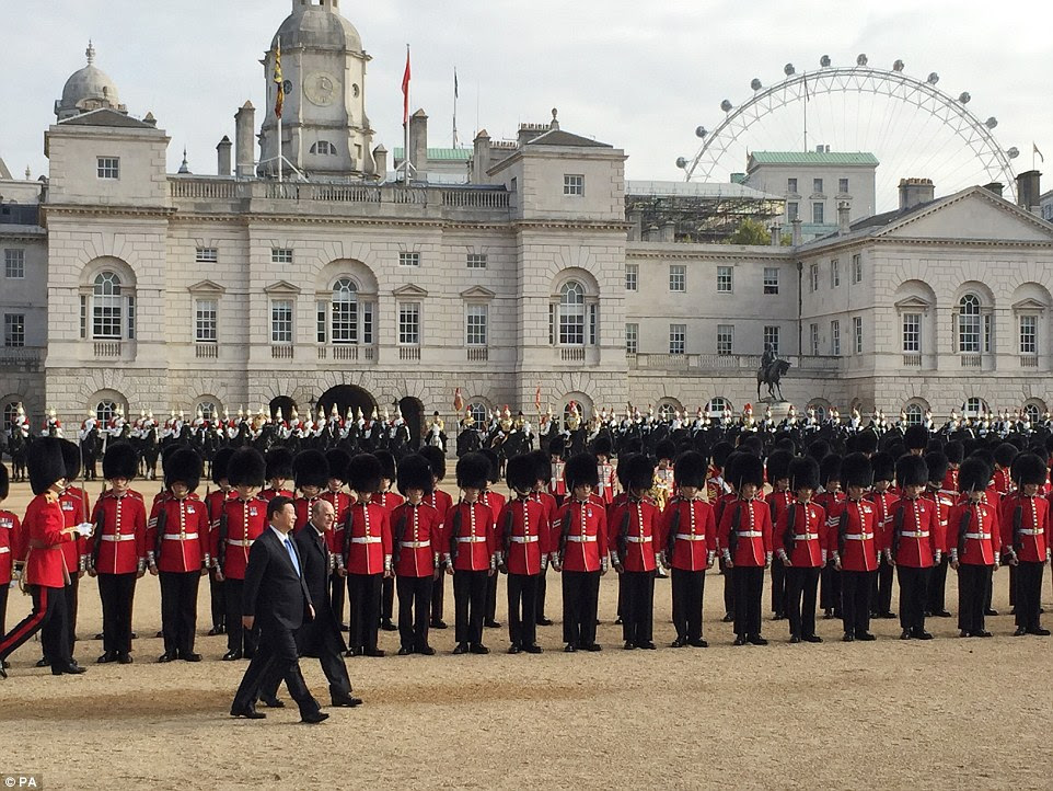 The Duke of Edinburgh accompanied Mr Xi as he inspected a Guard of Honour during the ceremonial welcome of his four-day state visit