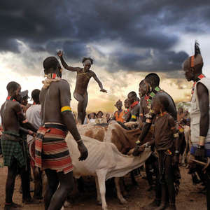 One of the runners-up: a Hamer man in Ethiopia's Omo Valley skilfully jumping over a row of bulls as part of a wedding ceremony.