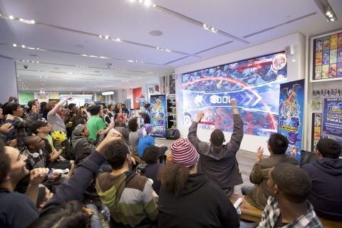 In this photo provided by Nintendo of America, fans gather at Nintendo NY to watch the Pokkén Tourna ...