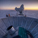 The Bicep2 telescope, in the foreground, was used to detect the faint spiraling gravity patterns - the signature of a universe being wrenched violently apart at its birth.