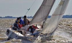J/27 one-design sailboat- sailing upwind off New Orleans, LA