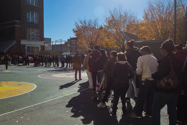 Voters in line outside a school in the Bronx on Tuesday.