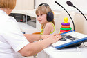 A child getting a hearing screening test.