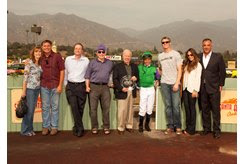 Tim Conway (center) presents the trophy for the 2012 Tim Conway Stakes at Santa Anita Park