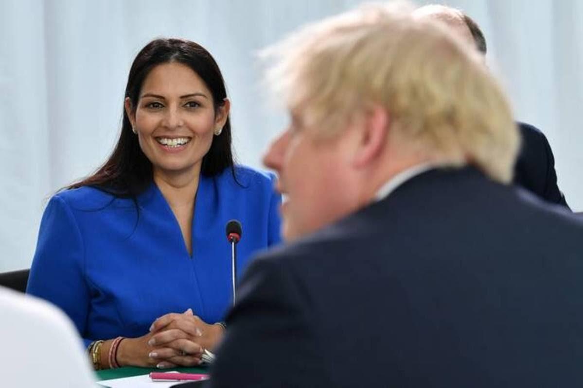 British Home Secretary Priti Patel looks on as British Prime Minister Boris Johnson chairs a cabinet meeting. (Paul Ellis/Reuters)