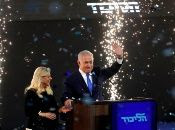 Confetti falls as Israeli Prime Minister Benjamin Netanyahu and his wife Sara stand on stage after Netanyahu spoke following the announcement of exit polls in Israel
