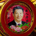 Portraits of President Xi Jinping are common, as are songs celebrating him as a friend of workers and an enemy of corruption.