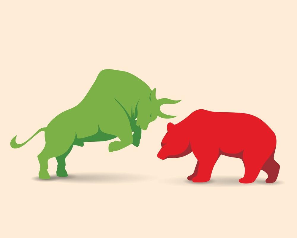 A bull up against a bear