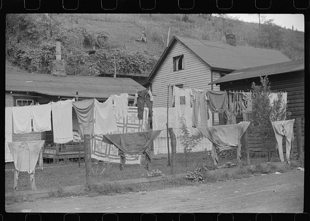 Clothes line on fence in front yard of coal miner's home, Scotts Run, West Virginia