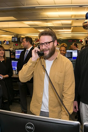 Seth Rogen answers the phones on the trading floor at ICAP's North American headquarters in Jersey City, NJ