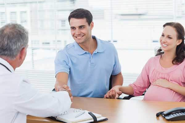 couple talking with doctor