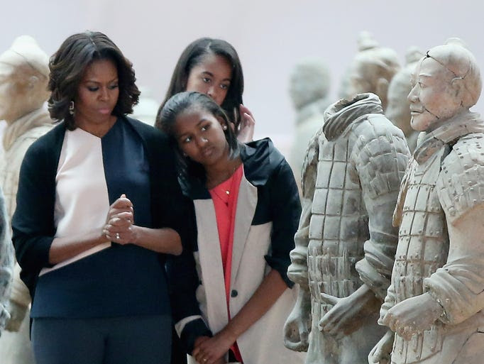 First lady Michelle Obama and daughters Malia and Sasha arrive in Xi'an, China, on March 24 and visit the Museum of Terra Cotta Warriors. The famous archaeological site is where some 8,000 life-size sculptures of Chinese warriors were buried with China's first unifying emperor more than 2,200 years ago.