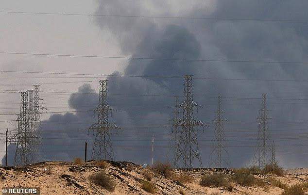 Smoke is seen following a fire at an Aramco factory in Abqaiq, Saudi Arabia, September 14