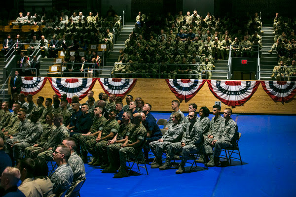 Military members listening to President Trump's address on Afghanistan at Fort Myer in Arlington, Va., on Monday.