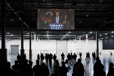 Supporters watched from the back of the hall as the Republican presidential candidate, Donald J. Trump, spoke at a campaign event in Novi, Mich., last month.