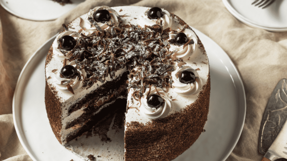 Refined and elegant, the Black Forest cake is the perfect choice for any holiday meal! This cake is the ideal combination of chocolate, whipped cream, and cherries. It contains several fluffy cocoa tops, separated by generous layers of whipped cream and cherry.