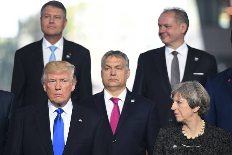 President Trump, Hungarian Prime Minister Viktor Orban and British Prime Minister Theresa May pose for a picture during the NATO summit. (Stefan Rousseau/Getty Images)