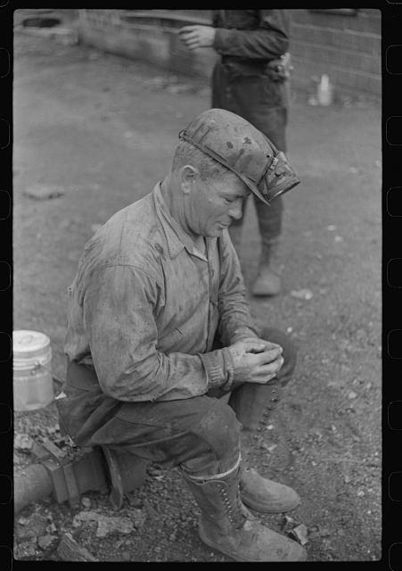 Coal miner waiting for the next shift, Bertha Hill, Scotts Run, West Virginia