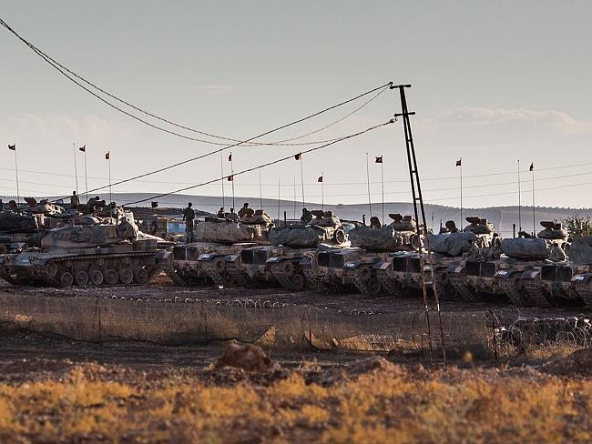 Battle lines ... Turkish tanks line up on the border with Syria.