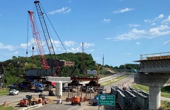 Crews working to set LRT bridge beams over Highway 212 in Minnetonka