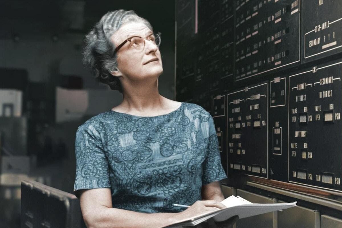 Nancy Grace Roman looking up at a large control panel