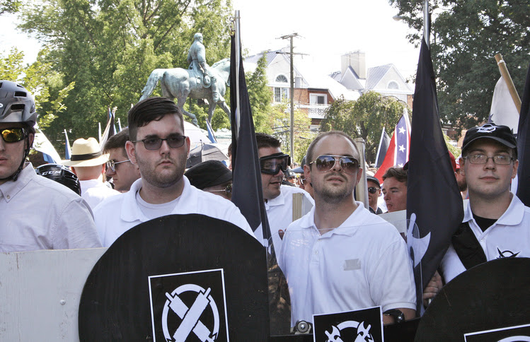 In this photo taken Saturday, James Alex Fields Jr., second from left, holds a black shield in Charlottesville during a white supremacist rally. (Alan Goffinski/AP)