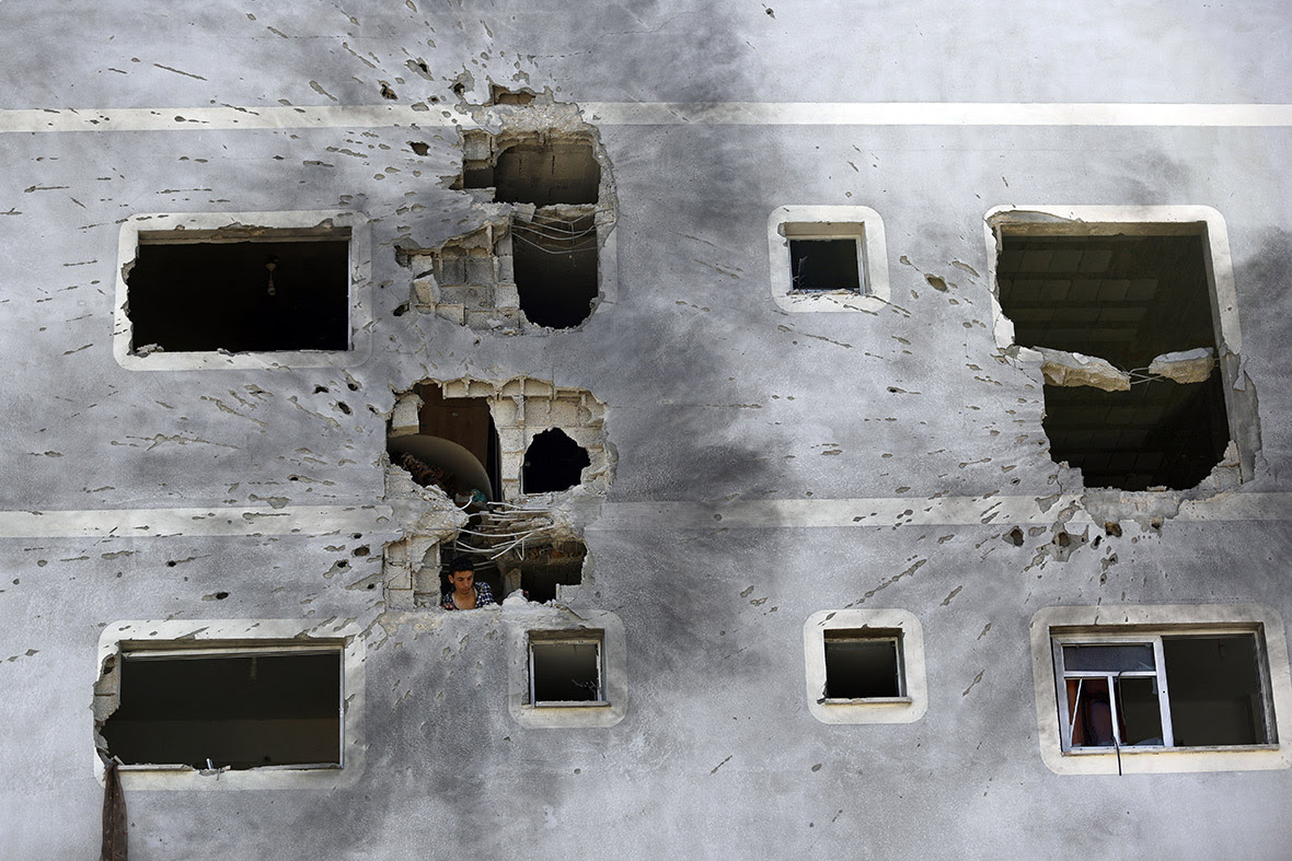 A Palestinian man inspects the damage to his home in Jabaliya in the northern Gaza Strip