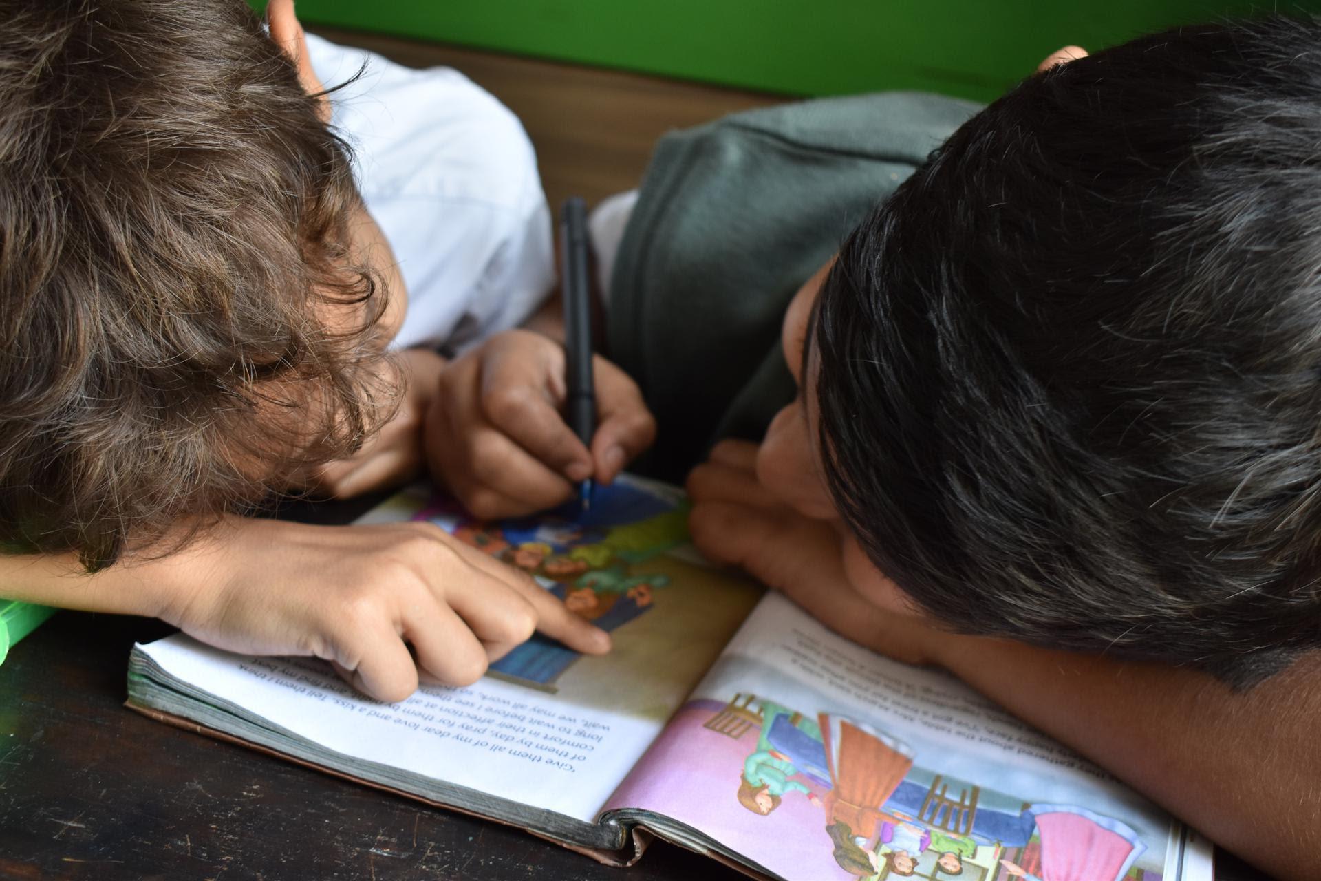 Two boys do homework together.