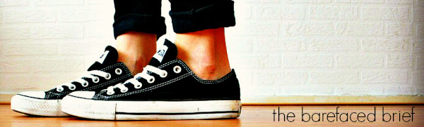 feet in converse sneakers