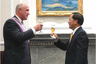 Taiwan's President Chen Shui-bian, right, toasts with American Institute in Taiwan (AIT) Director Douglas Paal during a meeting at the Presidential Palace, Monday, Jan. 23, 2006, in Taipei, Taiwan. Paal will leave the AIT, the US. de facto embassy in Taipei, after three-and-a-half years on Jan. 25 and has been awarded the Order of the Brilliant Star by President Chen. (AP Photo/Jerome Favre) (Photo credit should read JEROME FAVRE/AFP/Getty Images)
