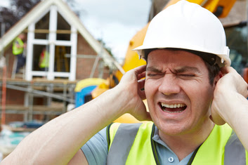 Construction worker holding ears