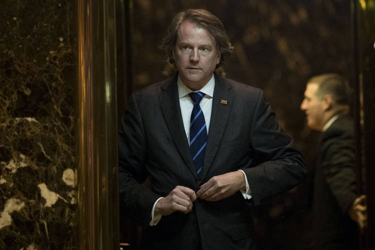 Don McGahn, general counsel for the Trump transition team, gets into an elevator in the lobby at Trump Tower. (Drew Angerer/Getty Images)