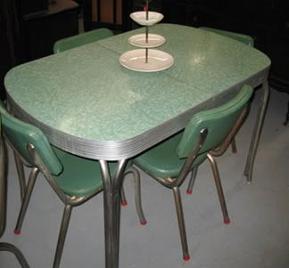 Formica table, vinyl chairs.  I would love to have one now