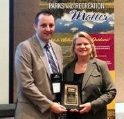 Secretary of State Ruth Johnson receiving MRPA award