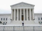 A policeman stands guard outside the Supreme Court, Washington, U.S.