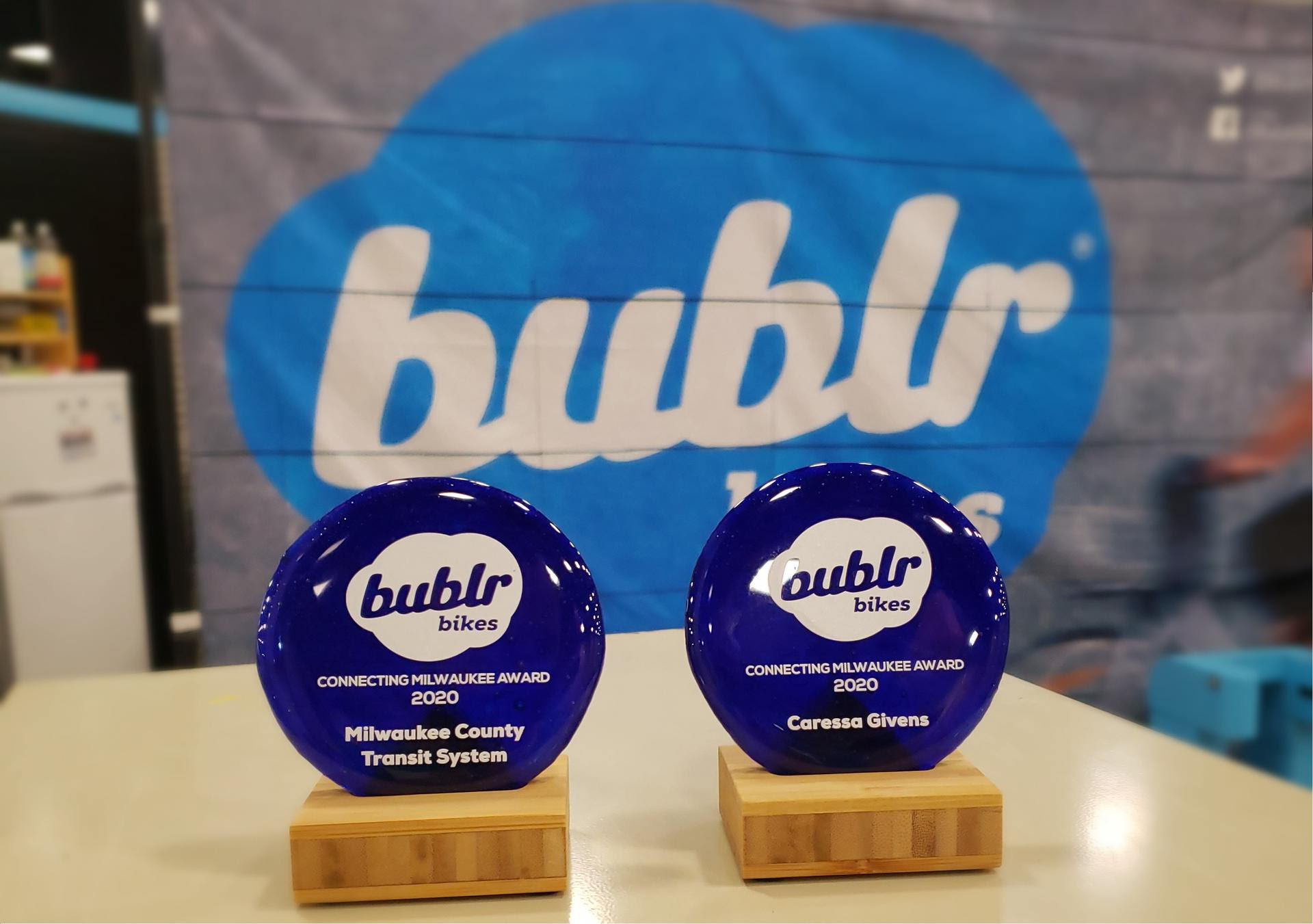 Image of two Connecting Milwaukee awards in front of a bublr branded backdrop