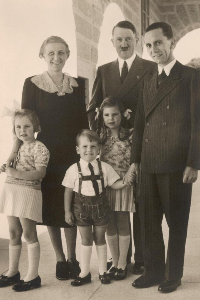 Goebbels with his wife, Magda, three of their six children, and the Führer in the 1930s