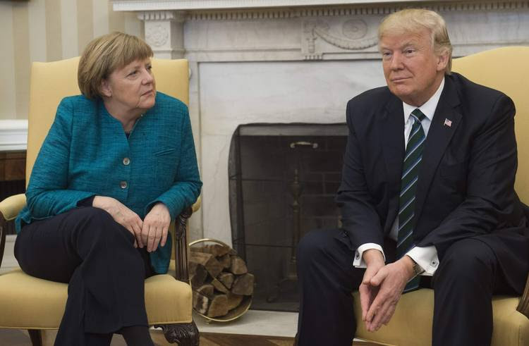 President Trump and German Chancellor Angela Merkel meet in the Oval Office in March. (Saul Loeb/AFP/Getty Images)