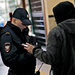 A police officer checked a man's identification last week in the central train station in Sochi, Russia, amid stepped-up security for the Olympic Games.